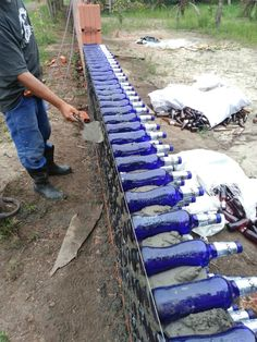 Changing the world one bottle at at time. - Home Bottle Brick. Changing the world one bottle at at time. Plastic Bottle House, Recycled House, Earthship Home, Glass Building, Recycled Glass Bottles, Bottle Wall, Earth Homes, Garden Fencing, Outdoor Projects