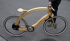 Matthias Broda, inventor and designer of the wooden e-bike, holds a prototype in Berlin. (Fabrizio Bensch/Reuters)