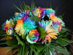 How to make rainbow colored flowers! This is incredible! I am totally doing this! I'll do a test batch soon :)