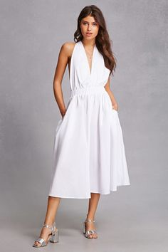 A retro-inspired woven dress featuring a self-tie halter neck, an elasticized waist, on-seam slip pockets, and a flowy A-line silhouette.<p>- This is an independent brand and not a Forever 21 branded item.</p>