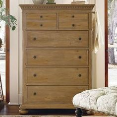 Perfect for stowing sweaters, jeans and skirts, this 6-drawer chest features a distressed oatmeal finish and poplar veneers. A convenient jewelry insert organizes heirlooms and accessories, while a pull-out clothing rod offers effortless storage for suits and jackets.      Product: Chest    Construction Material: Poplar veneers and hardwood solids    Color: Distressed oatmeal   Features: Part of the Paula Deen Home Collection  Six drawers    Jewelry tray Includes a pull-out clothing rod…