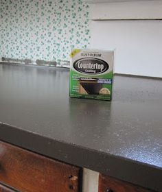 Rust-Oleum countertop coating $20 a can. Color: Clay.  Love it lots. [1 can covered 13 ft long counter top]