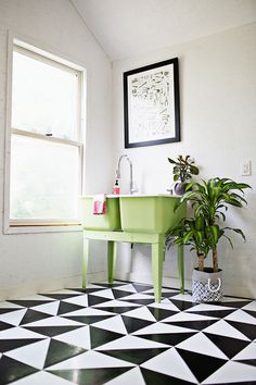 Diy patterned linoleum floor laundry room | Image via A Beautiful Mess