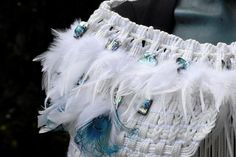 Size: Medium to Large Material: Polyester braid,clear beads, white feathers and Teal & Blue peacock feathers Taonga: Pieces of paua. White Feathers, Peacock Feathers, Peacock Blue, Teal Blue, Maori Designs, Maori Art, Cloak, Predator, Waterfall