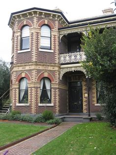 Beautiful brickwork on this home and lovely arched windows.  I think the brick exterior stands alone without needing the frilly gingerbread.  Would like to see the whole house.