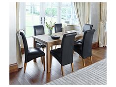 Sierra dining table and 6 darcy black chairs | Dining Room Furniture | Harveys