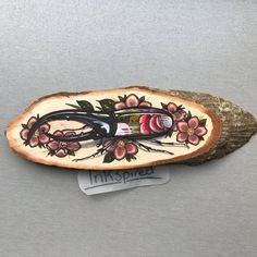 Wood slice with an original drawing of a hercules beetle and