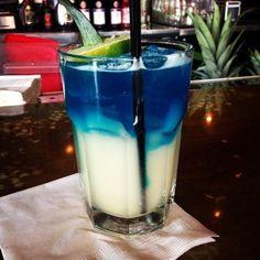 Fins up 1 The Sharknado Cocktail 4 oz. Raspberry Vodka 6 oz. Blue Curacao 2 oz. Cointreau 2 oz. Pineapple Juice 2 oz. Grenadine Sprite Goldfish bowl Three plastic toy sharks