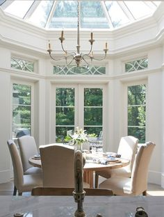 beautiful traditional dining room design with two story windows round table parsons chairs; I dig the window design Dining Room Design, Dining Room Table, Dining Area, Kitchen Dining, Sunroom Dining, Kitchen Nook, Traditional Dining Rooms, Traditional Windows, Traditional Chairs