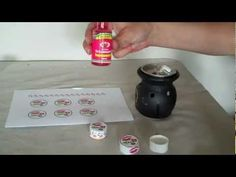 How to make your own lip balm containers - fold pieces of plastic shopping bag; iron under parchment paper; cut into strips and squares; assemble with hot glue (second half of video)