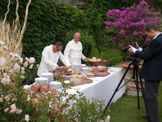 Italian Corner Prosciutto selection handcut in front of your guests and  served with Melon in the beautiful garden of Castello di Vincigliata