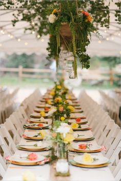 Family style seating under tent with floral chandeliers. Captured By: Ryan Price ---> http://www.weddingchicks.com/2014/06/02/no-cellphone-service-colorado-wedding/