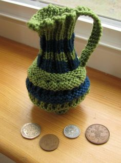 Free Knitting Pattern Pence Jug Coin Purse - Popular in the 19th century, pence jugs were coin purses shaped like a miniature water pitchers. Franklin Habit translated and modernized this pattern from the 1843 edition of Frances Lambert's best-selling My Knitting Book for present-day knitters. You can also use as a gift bag. A great stashbuster! Pictured project by theknittingmama