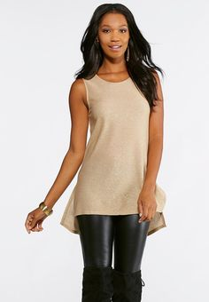 ee53c0f8766 This is your time to shine in this stunning metallic sparkle tunic. Wear  with a