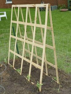 DIY - Folding Trellis for your Vegetable Garden -- easy to make, just add hinges at the top, folds flat for storage