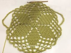 DROPS Crochet Tutorial: How to crochet the circle to the jacket in 141-1. In this DROPS video  we show how to work the circle for DROPS 141-...