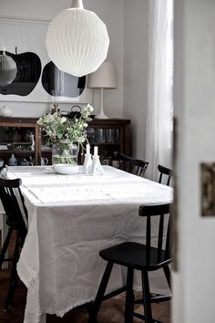 Classic dining space with linen table cloth in elegant Malmö home