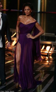 Purple patch: Nicole showed off her stunning figure in the sleek gown
