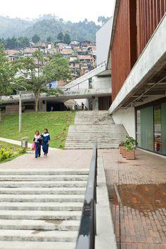 Image 2 of 33 from gallery of Antonio Derka School / Obranegra Arquitectos. Photograph by Alfonso Posada School Architecture, Modern Architecture, Cladding, Railroad Tracks, The Neighbourhood, Sidewalk, Gallery, Building, Design