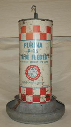 Vintage Purina P-16 Tube Feeder Chicken Poultry Sign Ralston Farm Red White...Vintage. Purina. P-16. Tube Feeder. Broilers, Chicks, Poultry. Tested an dApproved. Ralston Purina Company. 2' Tall (including hanging hook). Instruction for use on back. Metal. Red, white and blue paint. Rust, paint loss and some dents. Really great piece! Shipping, Handling and Insurance FREE. 1 of 2