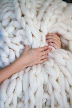 The original Giganto-Blanket throw pattern by Laura Birek -- super-bulky hand-knit blanket knit on giant PVC pipe knitting needles. Extreme home decor! :)