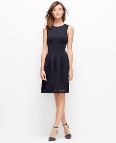 "A laser-cut hem and slight sheen intrigues this flattering stretch dress, redefining modern pretty. Pair with sleek ankle strap heels for the ultimate in ladylike luxe. Jewel neck. Sleeveless. Fitted bodice. Inverted box pleats at waist. Cutaway bands at hem. Hidden side zipper with hook-and-eye closure. 20"" from natural waist."