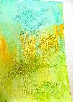 Art journal page yellow green twinkling paints and salt.