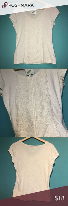 Beige Top Beige T-shirt with a frilly design down the middle. Works for casual and a bit fancy. dillards Tops Tees - Short Sleeve