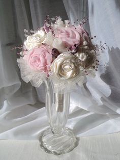 I sew, so it makes sense for me to me to do fabric and ribbon flowers for my and my maid of honor's bouquets. plus, they keep forever! Wedding Bouquets, Wedding Flowers, Wedding Bride, Dream Wedding, Bridal Brooch Bouquet, Brooch Bouquets, Diy Flowers, Fabric Flowers, Fabric Bouquet