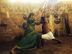"Defying age with a sword: Meenakshi Gurrukkal, Kerala's grand old Kalaripayattu dame ""Meenakshi Gurukkal crouched low, sword poised; her eyes unblinking as she faced her opponent in the mud-paved. Indian Martial Arts, Martial Arts Styles, Art Of Fighting, Unique Facts, Martial Artists, Cartoon Faces, Action Poses, Beautiful Places In The World, Drawing Poses"
