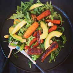 Roasted carrot, avocado, and arugula salads-- perfect salad for winter