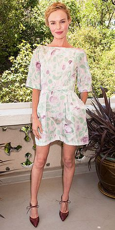 KATE BOSWORTH At the West Hollywood launch of her fashion app, Kate proves she knows a thing or two about the topic with a floral RED Valentino dress, eggplant-hued Bionda Castana heels and an intricate braided updo.