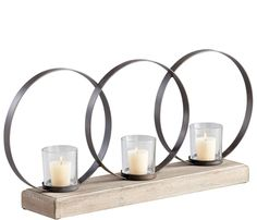 Circle Votive Candleholder - Three circle votive candleholder constructed of raw iron and natural wood. Candles not included.Shipping by mail is not