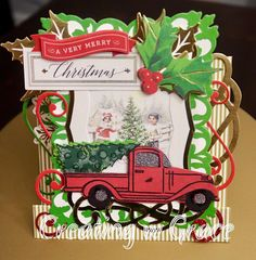 6x6 Anna Griffin Window frame card embellished w red vintage truck die cut embellishment and various layers of foil, glitter and textured card stock