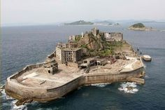 Nearly forty years after people, the Japanese island of Hashima is lifeless, sagging and absolutely uninhabitable to man, unless of course you're a crazed nemesis of James Bond, plotting to take down the British secret service. If you managed to get past the round-the-block queues outside of cinema Hashima Island, Harvard Gsd, Unique Buildings, Craftsman Style Homes, Chernobyl, Filming Locations, Historical Sites, Plymouth, Yorkie