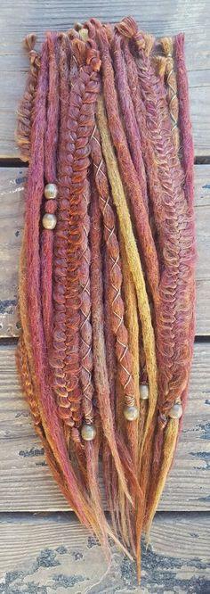 Set of 30 (half head) 25 dreadlocks, 5 braids Texture- interior crochet, natural inspired dreadlocks Colors- Autumn blend of red wine, sweet red, copper, burnt orange, amber, gold, caramel, wheat blonde Embellishments- beads, thread Clip in- optional Length- 14-20 Custom