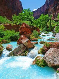 Turquoise Stream - This beautiful scenery is located on the Havasupai Reservation, which is at the western end of the Grand Canyon. To reach this location, you must either hike or ride a donkey 8 miles down to the village, then hike an additional 3 miles. Available as a print on paper, canvas, metal, or acrylic, or as a greeting card. Original photograph by Alan Socolik. All Rights Reserved © 2013 Alan & Marcia Socolik. #Photography #Landscape #SouthwestArt #Arizona #GrandCanyon #Decor…