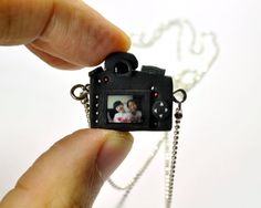 To all the fabulous daytrippers with cameras out there .....Personalized Nikon D7000 Camera miniature necklace