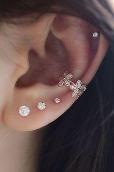Cute Triple Earlobe Ear Piercing Ideas for Women Triple Ear Piercing, Body Piercing, Cute Ear Piercings, Labret, Piercing Ideas, Silver Flowers, Black Silver, Swarovski Crystals, Diamond Earrings