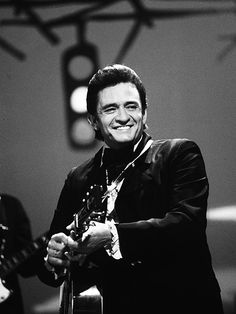 """Performing inside Folsom Prison was an appropriate choice for the outlaw country musician known as """"The Man in Black. Country Musicians, Country Music Artists, Country Singers, Johnny Cash June Carter, Johnny And June, Classic Country Artists, Johnny Cash American, John Cash, 50s Music"""