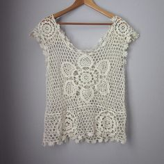 Lace top 100% cotton. Gently worn -- excellent condition! Mandala like pattern. Festival wear.   Bundle for best deals! Hundreds of items available for discounted bundles! You can get lots of items for a low price and one shipping fee!  Follow on IG: @the.junk.drawer isela Tops