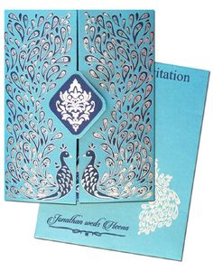 www.regalcards.com now showcasing these luxurious Peacock theme invitation cards with exclusive and intrinsic gold and silver foil work.