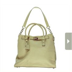 Sold out  Michael Kors Hamilton Bag NWOT Price is firm Manufacturer: MICHAEL Michael Kors Size: Extra Large Manufacturer Color: Beige Retail: $358 Condition: New Dust Bag not included lock and key are missing has stain that May or may not come out not visible on pictures  Style:Tote :Handle Type: Convertible Compartment: Open Slip Closure: Magnet Bag Height (Inches): 13 Inches Bag Width (Inches): 14 1/4 Inches Bag Depth (Inches): 4 1/4 Inches Strap Drop (Inches): 12 1/2 Inches Fabric Type…