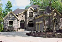 House Plan 3323-00115 - Lovely Cottage home with courtyard entry and beautiful exterior elements. The interior features approximately 2,443 square feet of living space with three bedrooms and three plus baths.