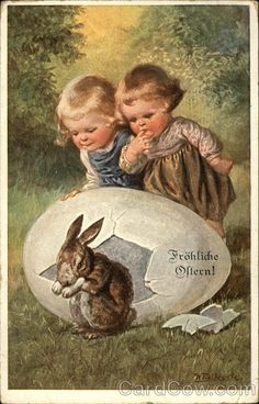 Happy Easter with Young Children watching Bunny Hatch from an Egg