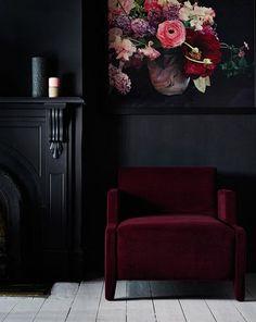 Black Wall Interior dark maroon furniture and art