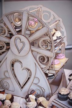 Ferris wheel cupcake holder, holds 16 cupcakes by CleverlyBuilt, $289.00 / Carnival