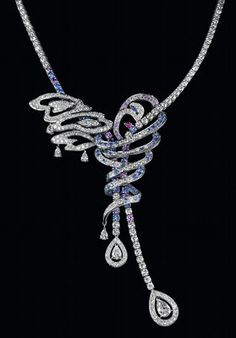 O Necklace set in white gold with a pear shaped diamond, pave diamonds, blue and purple sapphires and rubies