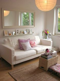 mirror above the couch and the shelf