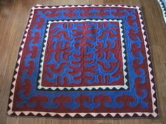 Square Shyrdak -  Shrydak is about 5ft by ft in deep red and royal blue $450.00